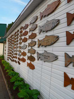 Fish donation plaques on display outside of the museum.